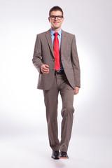 young business man walking toward camera