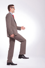 side of a young business man walking forward
