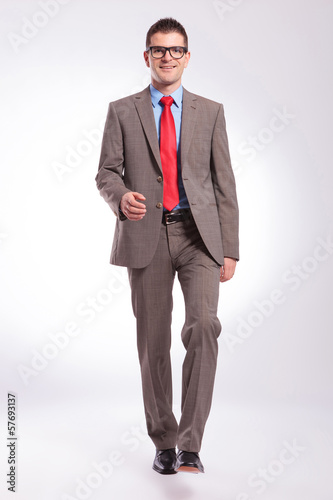 young business man walking toward camera
