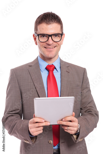 young business man holds tablet with both hands