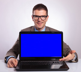young business man presents his laptop