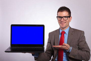 young business man presents laptop