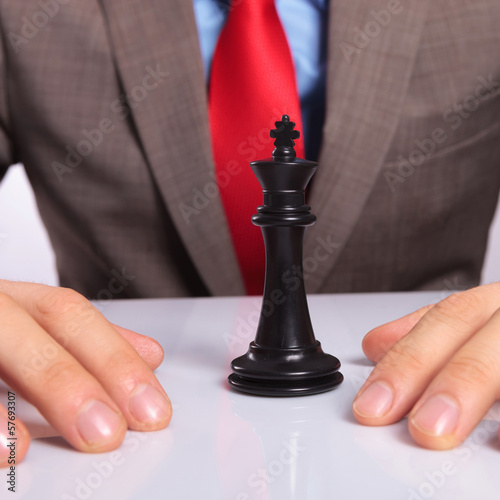 young business man with the black chess king