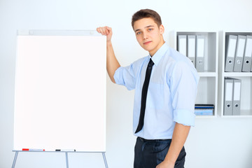 Young businessman with a flip chart during a presentation
