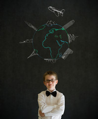 Boy as business man with chalk world wonders on background