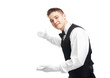 young happy smiling waiter gesturing welcome - 57694112