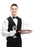 Young smiling waiter holding glasses of wine