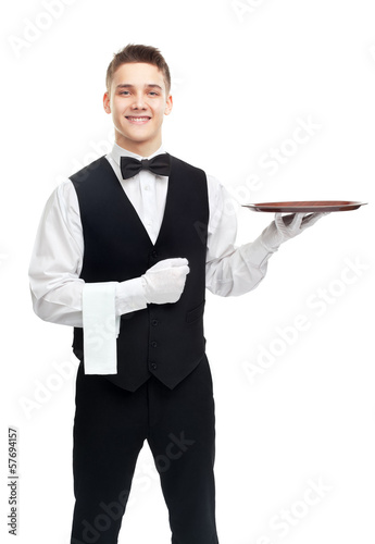 Young smiling waiter with empty tray