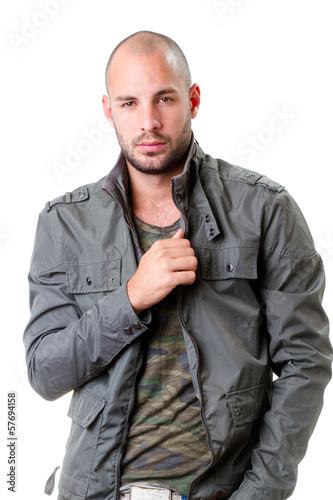 young man portrait, he wearing army t-shirt and grey jacket