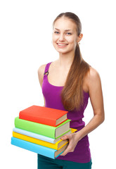 Happy smiling student girl holding stack of books