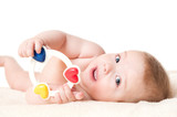 Baby playing with a rattle, isolated on white