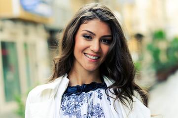 Beautiful woman smiling in urban background