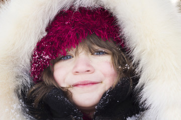 Girl with red hat and fur clothes