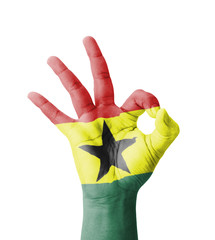 Hand making Ok sign, Ghana flag painted