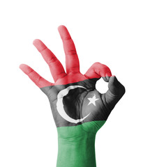 Hand making Ok sign, Libya flag painted