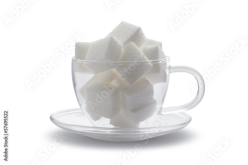 cubes sugar in glass cup isolated on white background