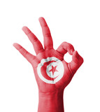 Hand making Ok sign, Tunisia flag painted