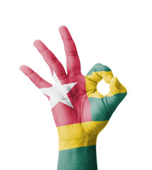 Hand making Ok sign, Togo flag painted