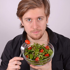 man eating fresh salad
