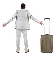 Businessman traveling with suitcas
