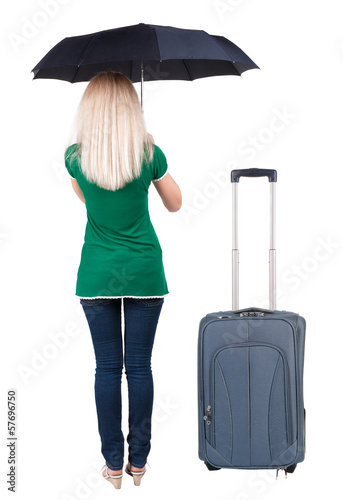 back view of woman standing with black umbrella traveling with s