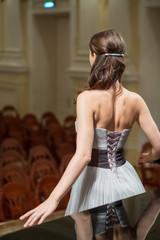 opera singer is back in concert hall, focus on girls back.
