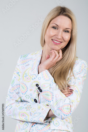 Beautiful smiling young blonde woman in a white jacket