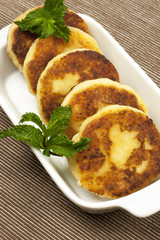 cottage cheese pancake with  mint leaves decoration