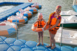 Mother and daughter on dock with round inflatable boats