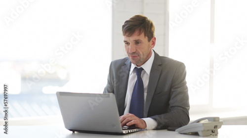 businessman with laptop computer and phone