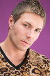 Closeup portrait of beautiful man in fashionable leopard t-shirt