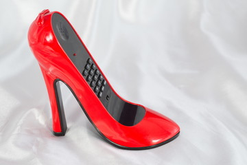 The stylish phone in the form of high-heeled shoes