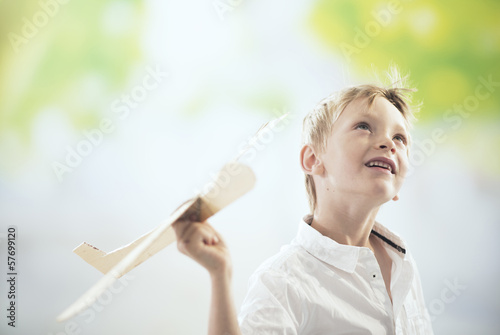boy flying a wooden plane