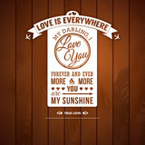 Love you poster in retro style on a wooden background.