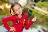 Cute girl with ponytails outdoors. poster