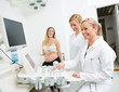 Gynecologists Using Ultrasound Machine At Clinic