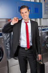 Businessman With Suitcase And Suitcover In Laundry