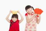 happy  kids showing red envelope and gold for chinese new year