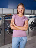Beautiful Woman Standing Arms Crossed In Laundry