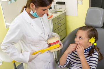 Little girl in the dentist office
