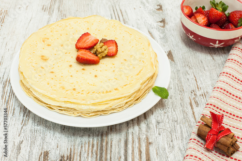 Pile of pancake and ingredients
