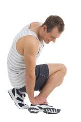 Sportsman feeling pain in his foot.