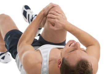 Man feeling pain in his knee.