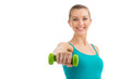 Nice smiling woman exercising with dumbbells.