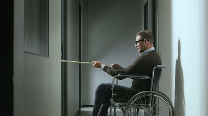 disabled business man on wheelchair playing tug of war