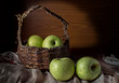 Still life green apples and old basket