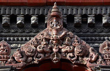 Carved wooden details on a Nepalese temple door