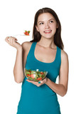 Young girl eating salad