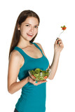 A young girl, a salad, a healthy diet