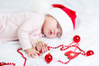 sleeping baby girl Santa Claus